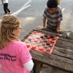 Miles-and-Shannon-playing-checkers